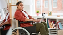 Woman sitting in wheelchair